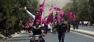 After a bloody month in Afghanistan, demonstrators demand security reforms