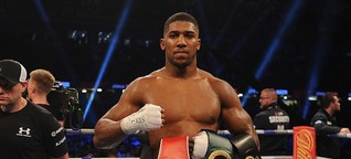 Anthony Joshua beats Carlos Takam in tenth round to retain world heavyweight titles