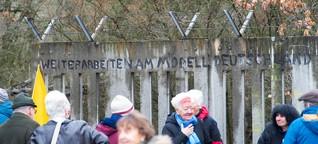 Versöhnung im Wald: Ein Stück Startbahnmauer steht wieder